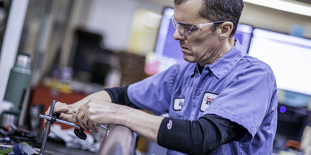 Man working on a hydraulic cylinder