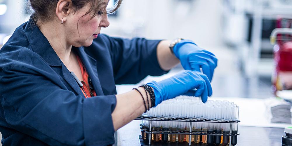 Woman testing hydraulic oil