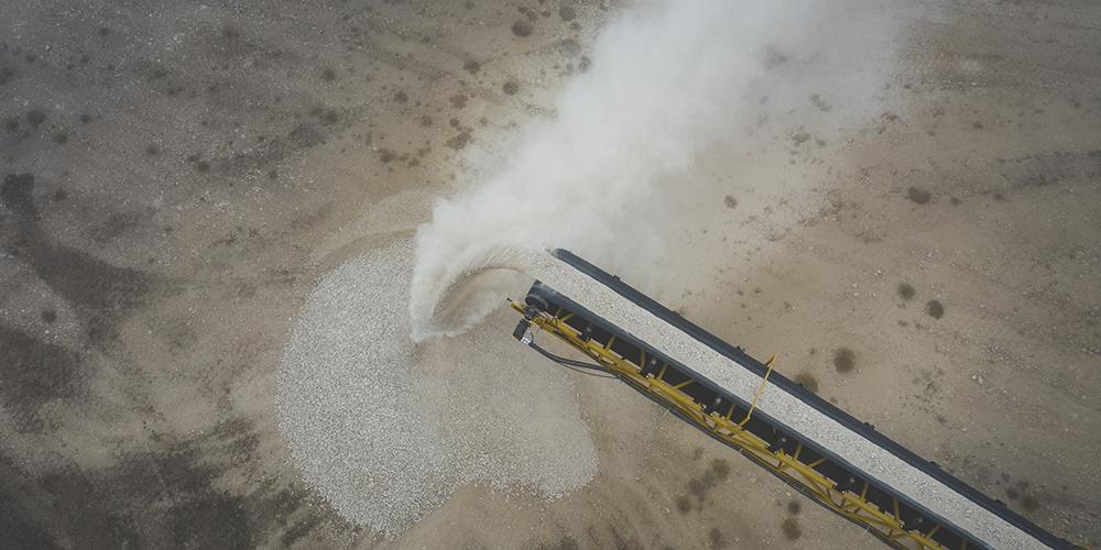 drone shot of conveyor moving limestone