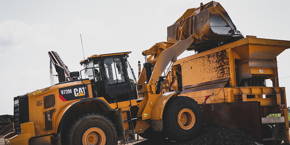 CAT loader putting product into an IROCK Crusher
