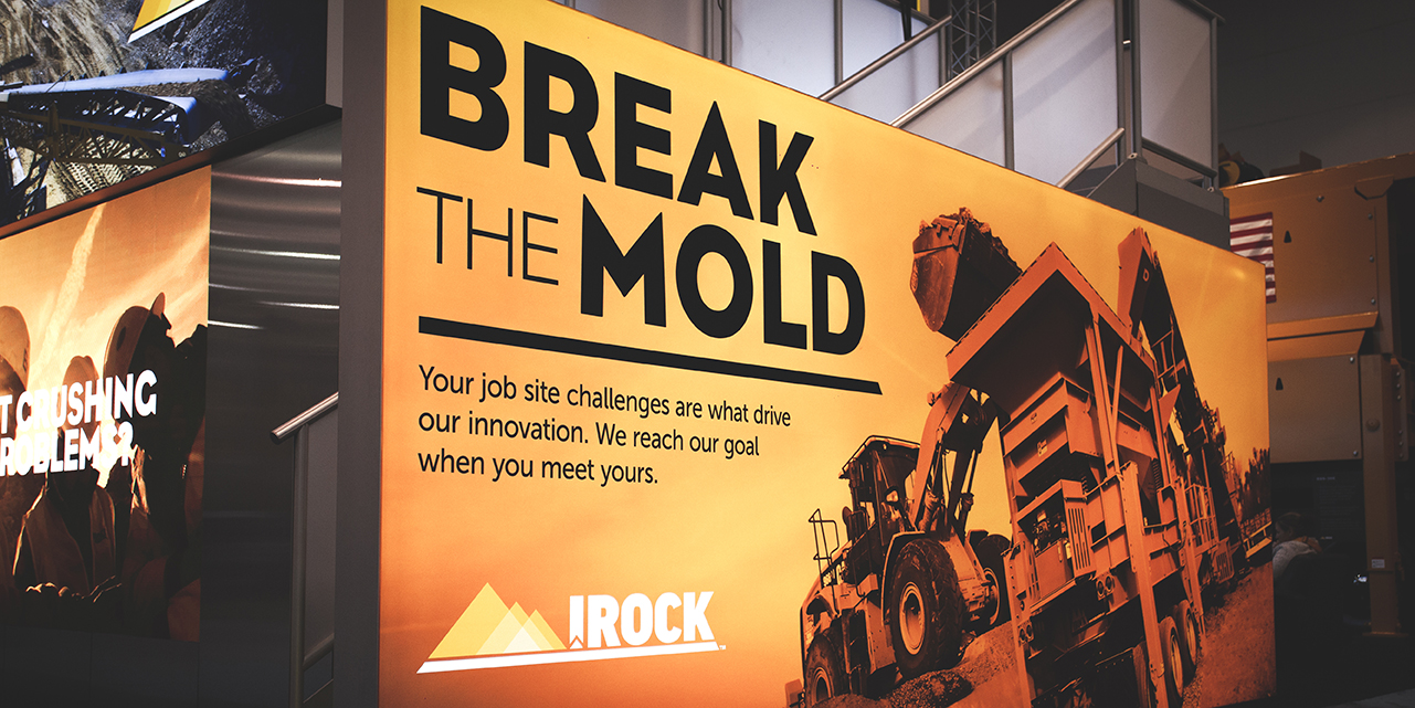 Up close of the irock trades how booth Break the Mold poster