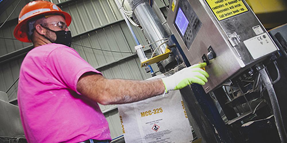 US aggregate employee filling a bag full of calcium carbonate