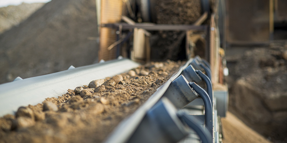 close up photo of aggregate on a conveyor
