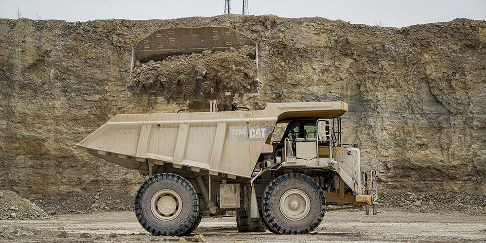 product being loaded into a dump truck
